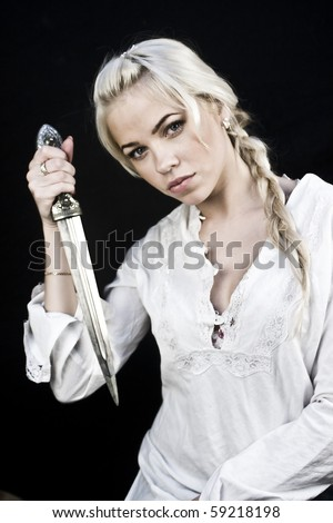 Young blonde woman with a big knife