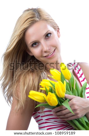 Young blonde woman with flowers yellow spring tulips bouquet smiling isolated on white background