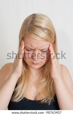 young blonde woman with splitting headache