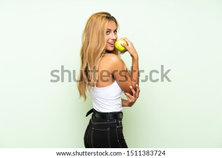 Young blonde womanYoung blonde woman with an apple over isolated background