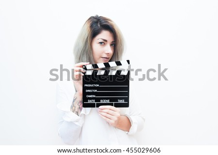 Young blue eyes blonde woman actress audition with movie clapper on white background #455029606