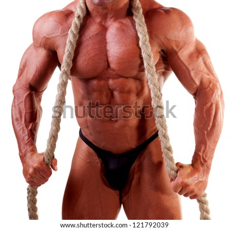 young bodybuilder posing with rope