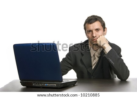 young bored business man working with is laptop