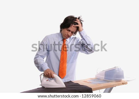 Young bored businessman doing the ironing, isolated in white background