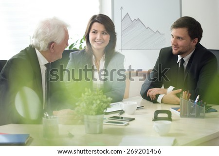 Young boss with employees during business meeting