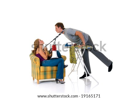 Young bossy woman with megaphone man ironing clothing. Studio, white background.