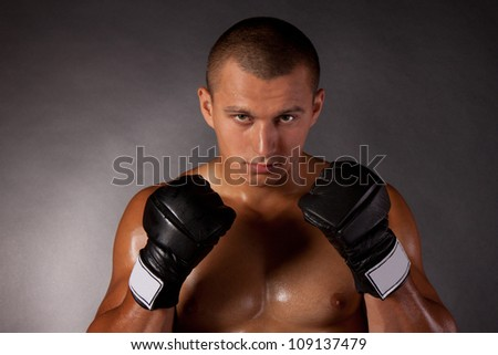 Young Boxer fighter over black