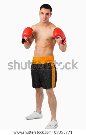 Young boxer fighting against a white background