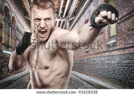 Young boxer in front of urban style