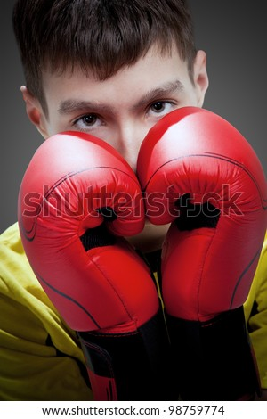 young boxer in red gloves