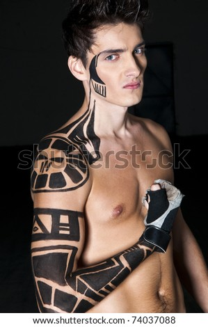 stock photo Young boxer with tattoo on his shoulder and arm
