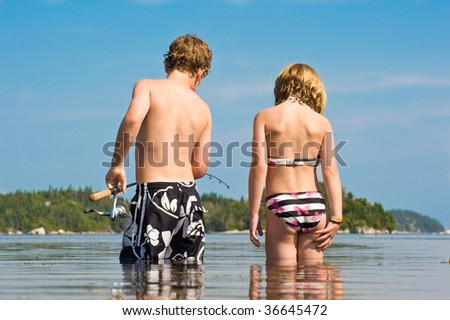 Young boy and girl fishing