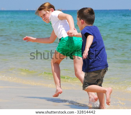 boy and girl holding hands on the beach