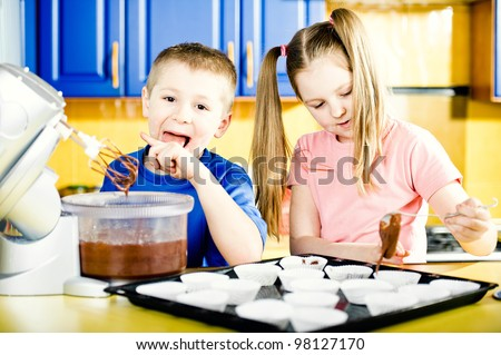 Young boy and girl making chocolate muffins