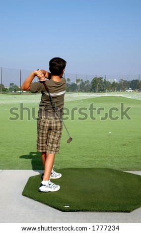 Young boy at Golf Range - stock photo