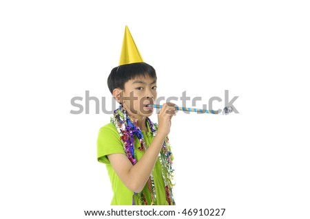 Young Boy Blowing a Party Favor and Wearing a Party Hat
