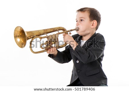 young boy blowing into a...