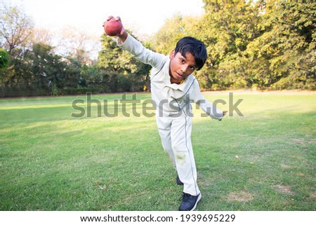 Young boy bowling leg spin in a cricket Stockfoto ©