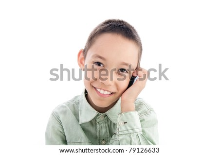 young boy calling on the cellphone isolated on white