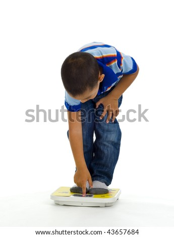 young boy checking his weight, isolated on white