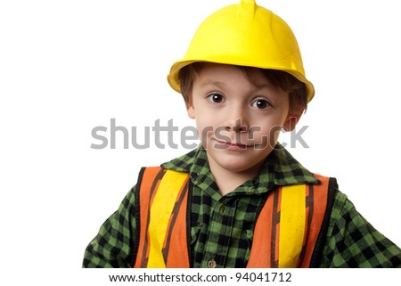 young boy construction worker in a hard hat , on a white background