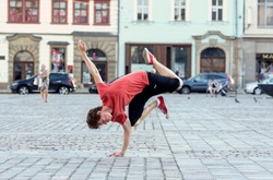 Young boy dancing breakdance on the street