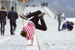 Young boy dancing breakdance on the street in Prague