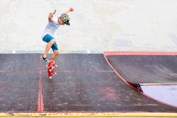 Young boy doing the trick on the ramp