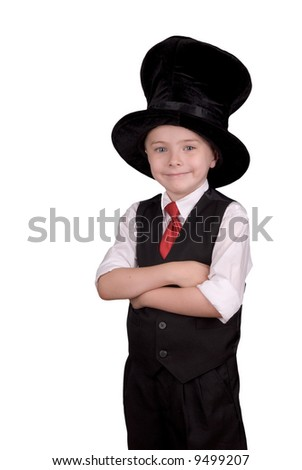 Young boy dressed as a magician with a hat over a white background