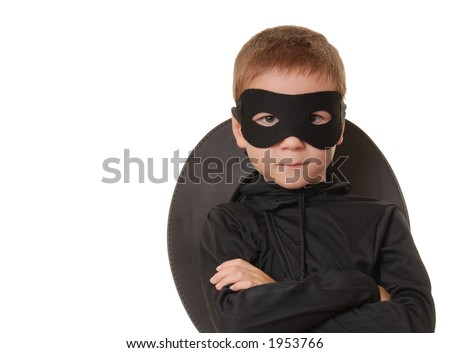 Young boy dressed in Zorro halloween costume