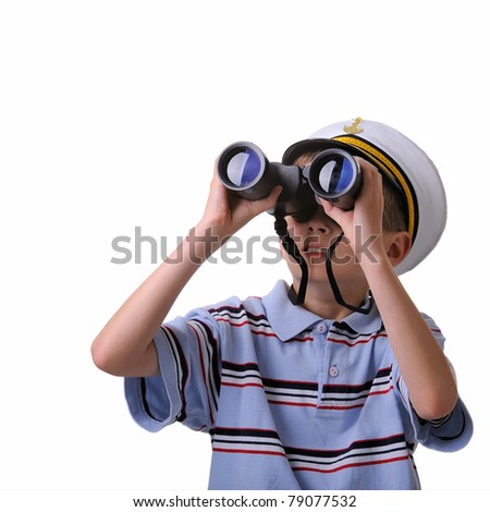 young boy dressed like a sailor looking into a binoculars isolated on white