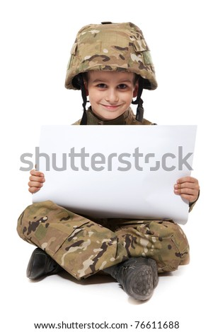 Young Boy Dressed Like a Soldier holding banner isolated on white