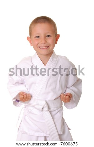 Young boy dressed wearing a karate outfit