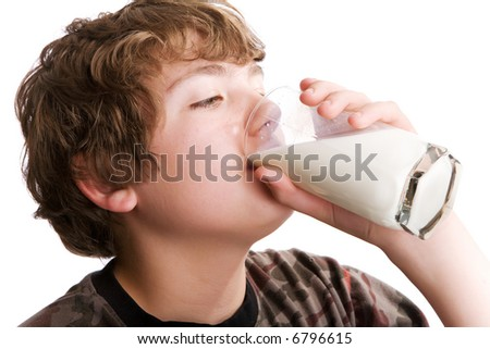 Young boy drinking a glass of milk