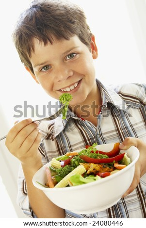 Young Boy Eating A Healthy Salad