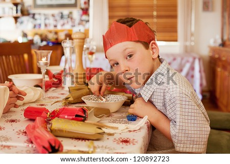 Young boy eating soup at Christmas lunch