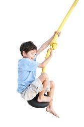Young boy enjoying on balancing activity  isolated on white background.