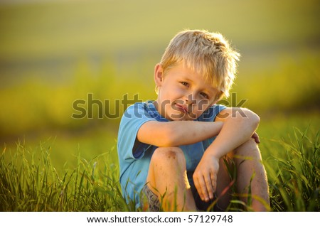 young boy enjoys his time outside in the field