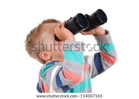 Young boy explorer searching with binoculars
