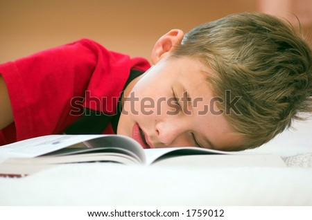 Young boy fell asleep after hard studying
