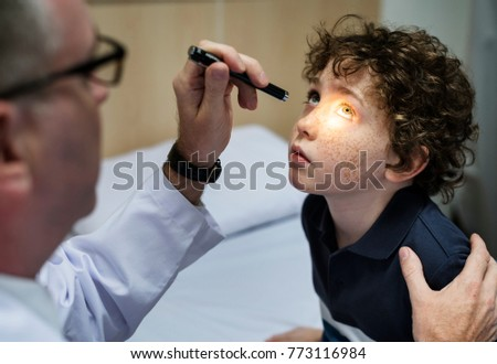 Young boy having his eyes checked