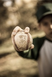 Young boy holding a baseball