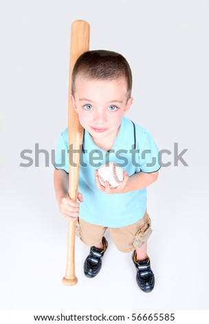 Young boy holding a baseball bat and ball on white background