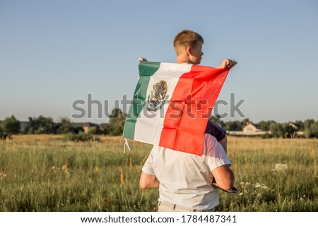 """Young boy holding flag of Mexico. """"September 16. Independence Day of Mexico. Mexican War of Independence, 1810."""""""