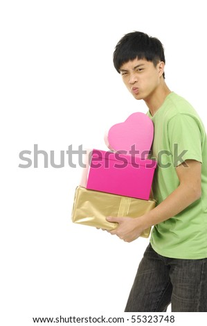 Young boy holding lots of gifts