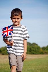 Young boy holding Union Jack flag