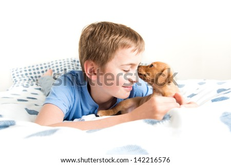 Young Boy Hugging his Puppy - stock photo