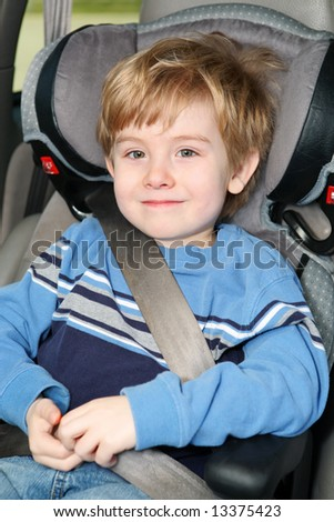 Young boy in a booster seat