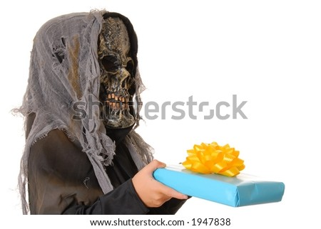 Young boy in a ghoul halloween costume with gift
