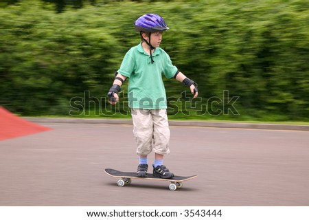 Young boy in action on his skateboard.